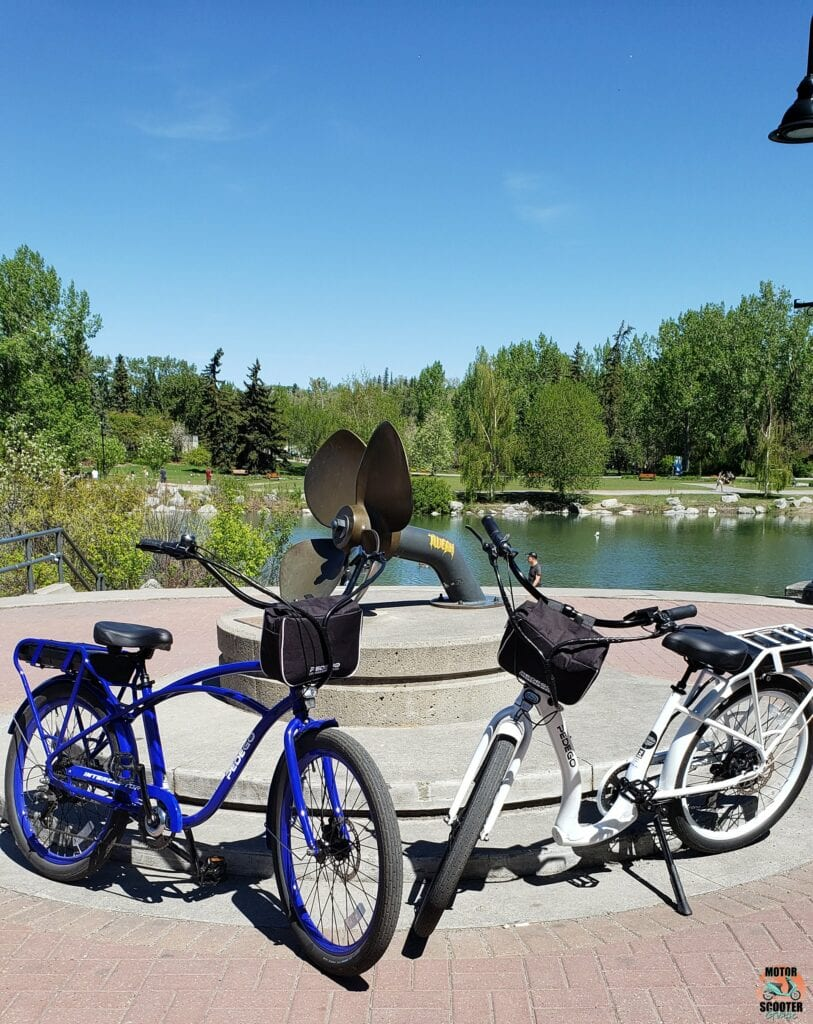 2021 Pedego Interceptor and 2021 Pedego Boomerang in front of Eau Claire