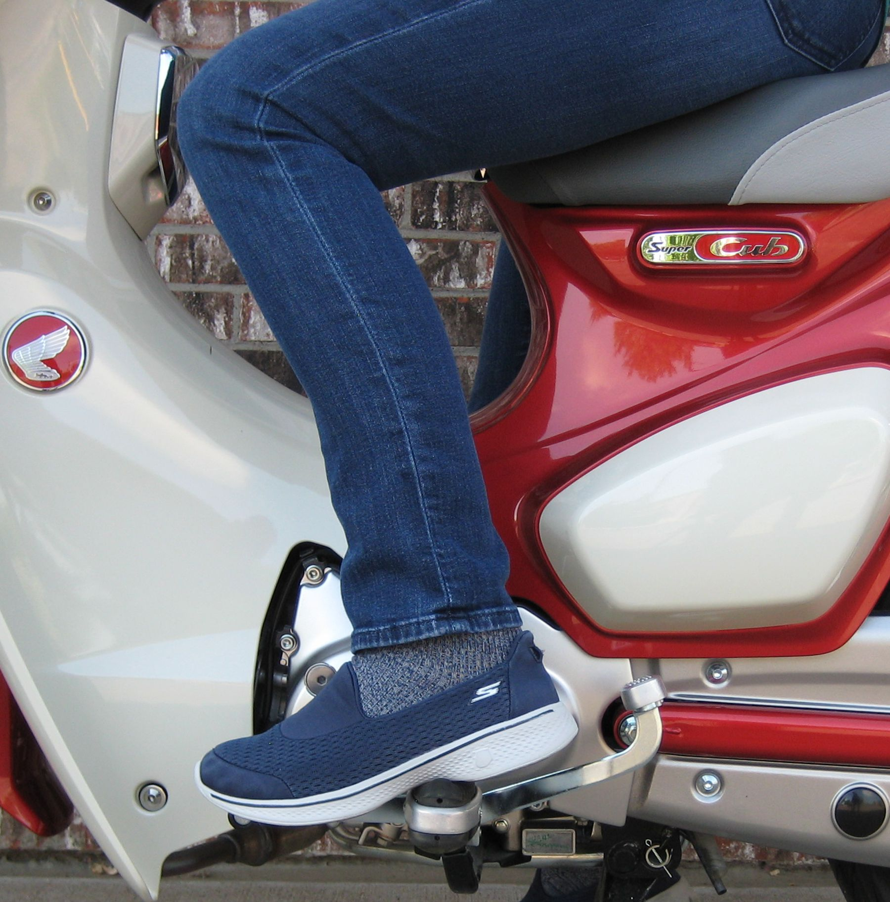 Rider foot in downshift position