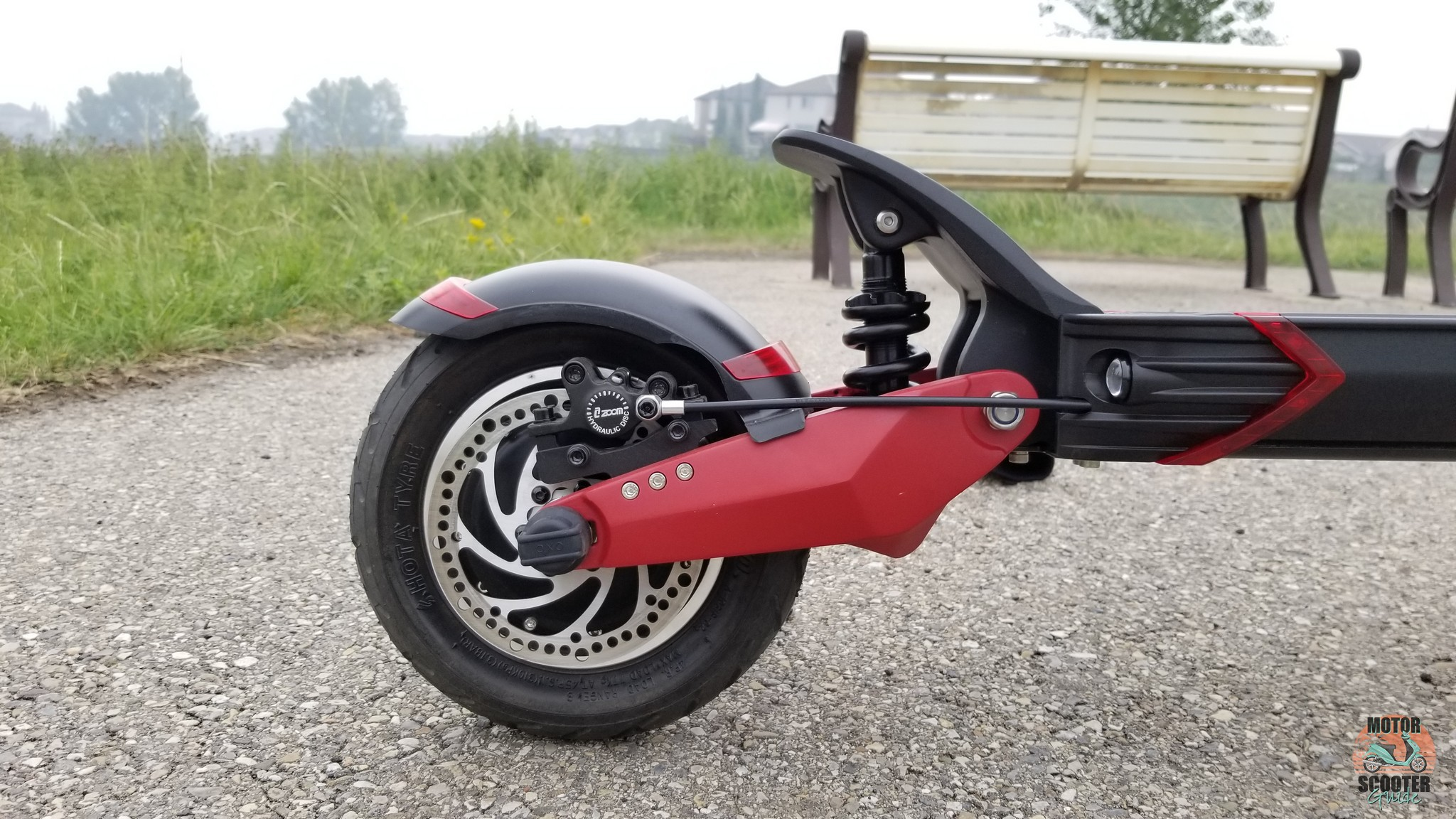 Closeup of rear wheel showing off disc brakes and suspension