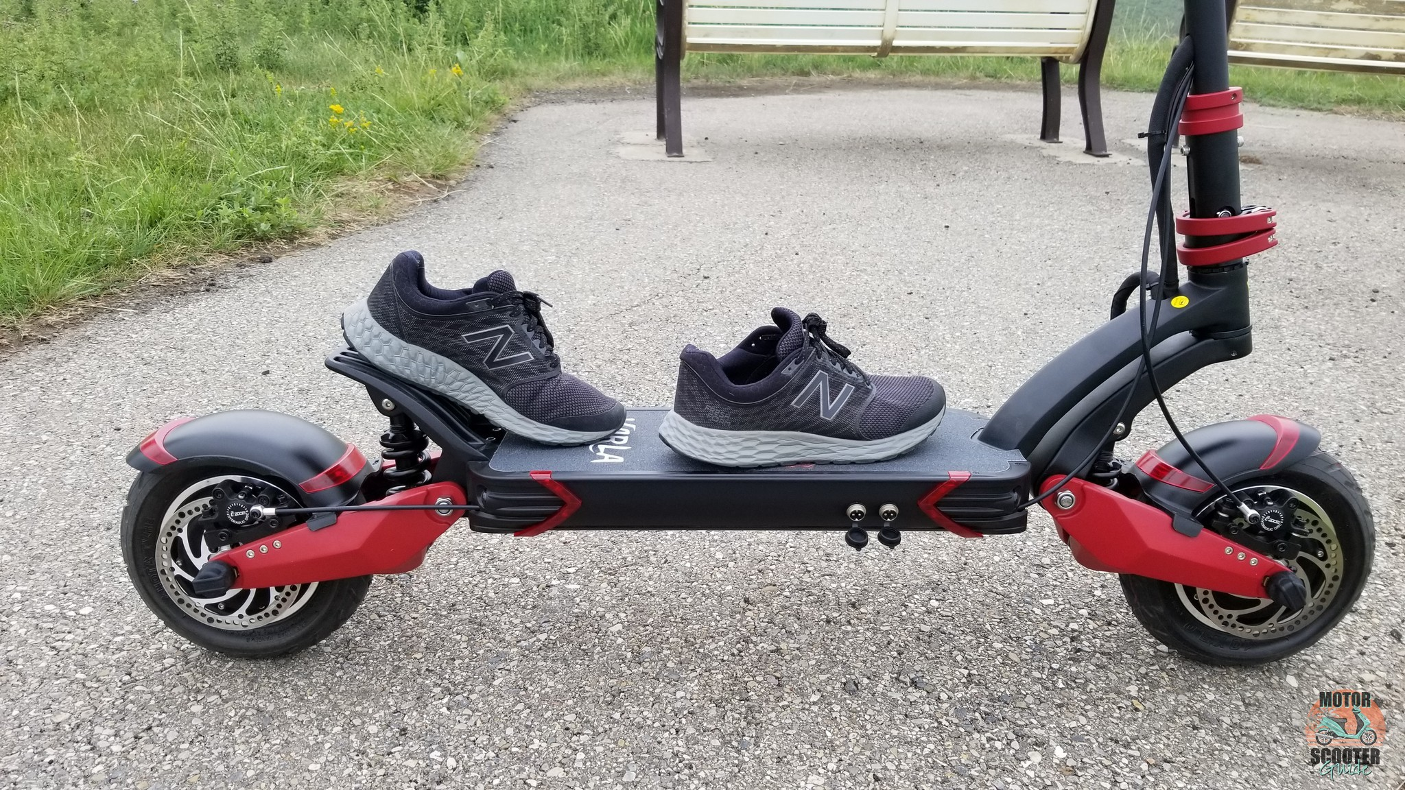 Shoes on the Varla Eagle One scooter simulating riding form