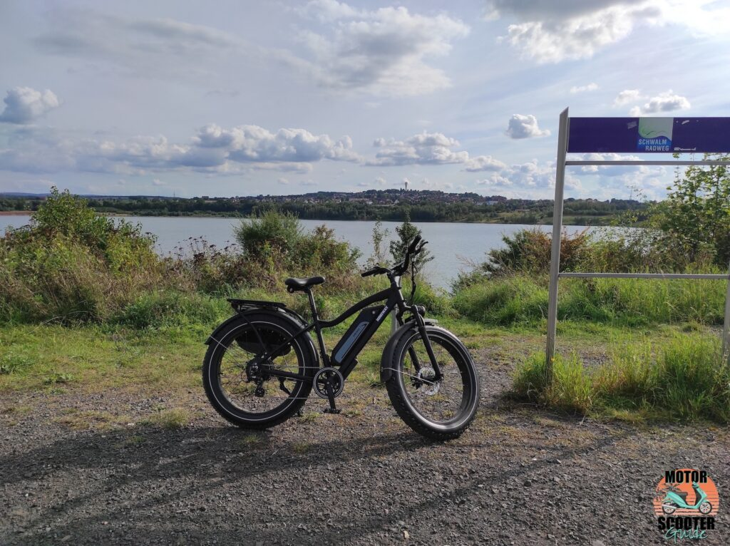 2021 Himiway All-Terrain Cruiser parked on dirt road next to lake