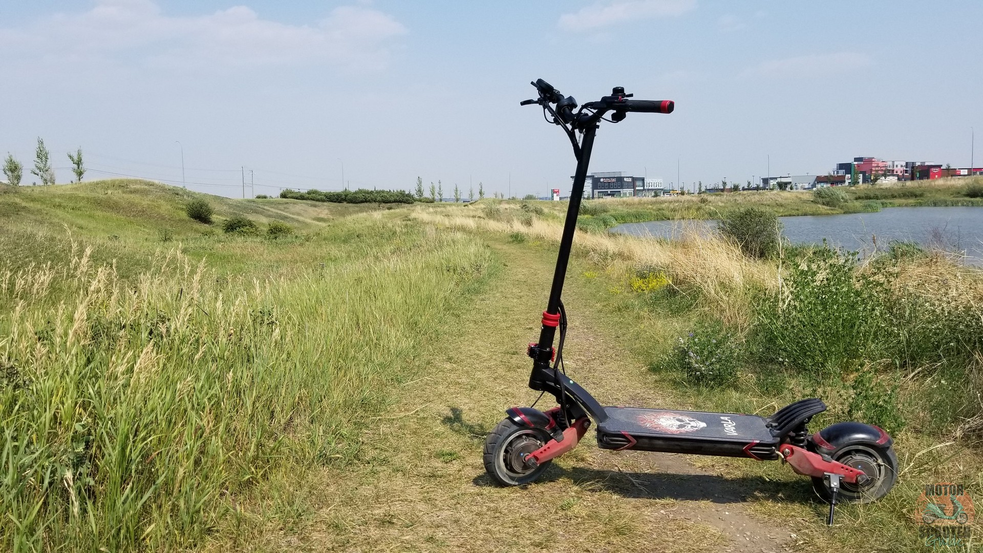 Varla Eagle One scooter on grass path