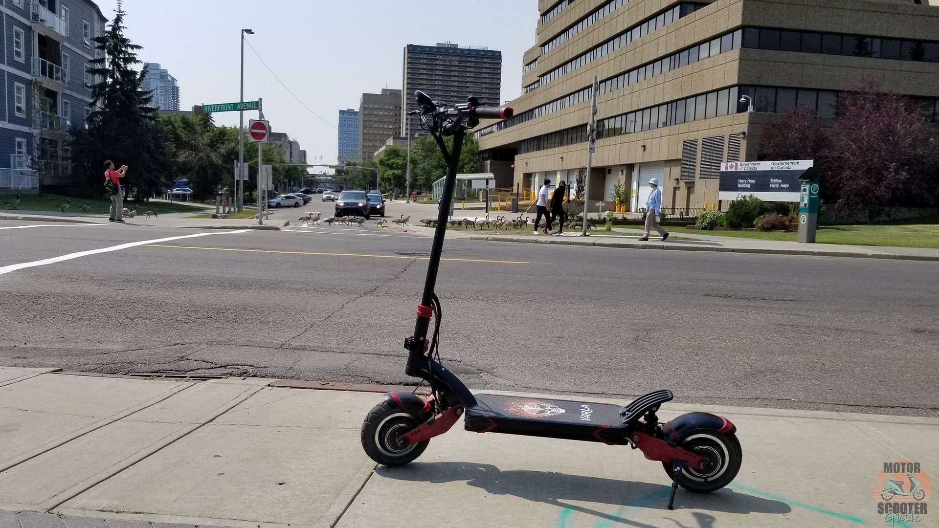Varla Eagle One scooter on the sidewalk in downtown Calgary