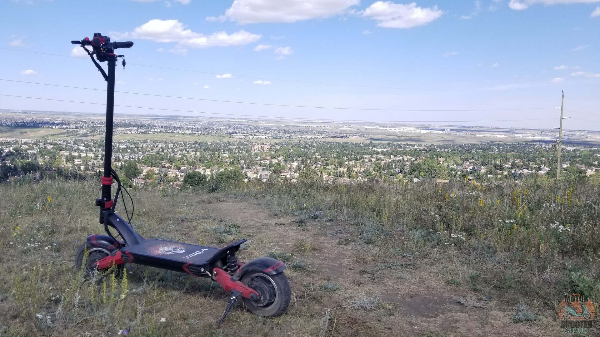 Eagle One scooter at the top of Nose Hill park overlooking the city