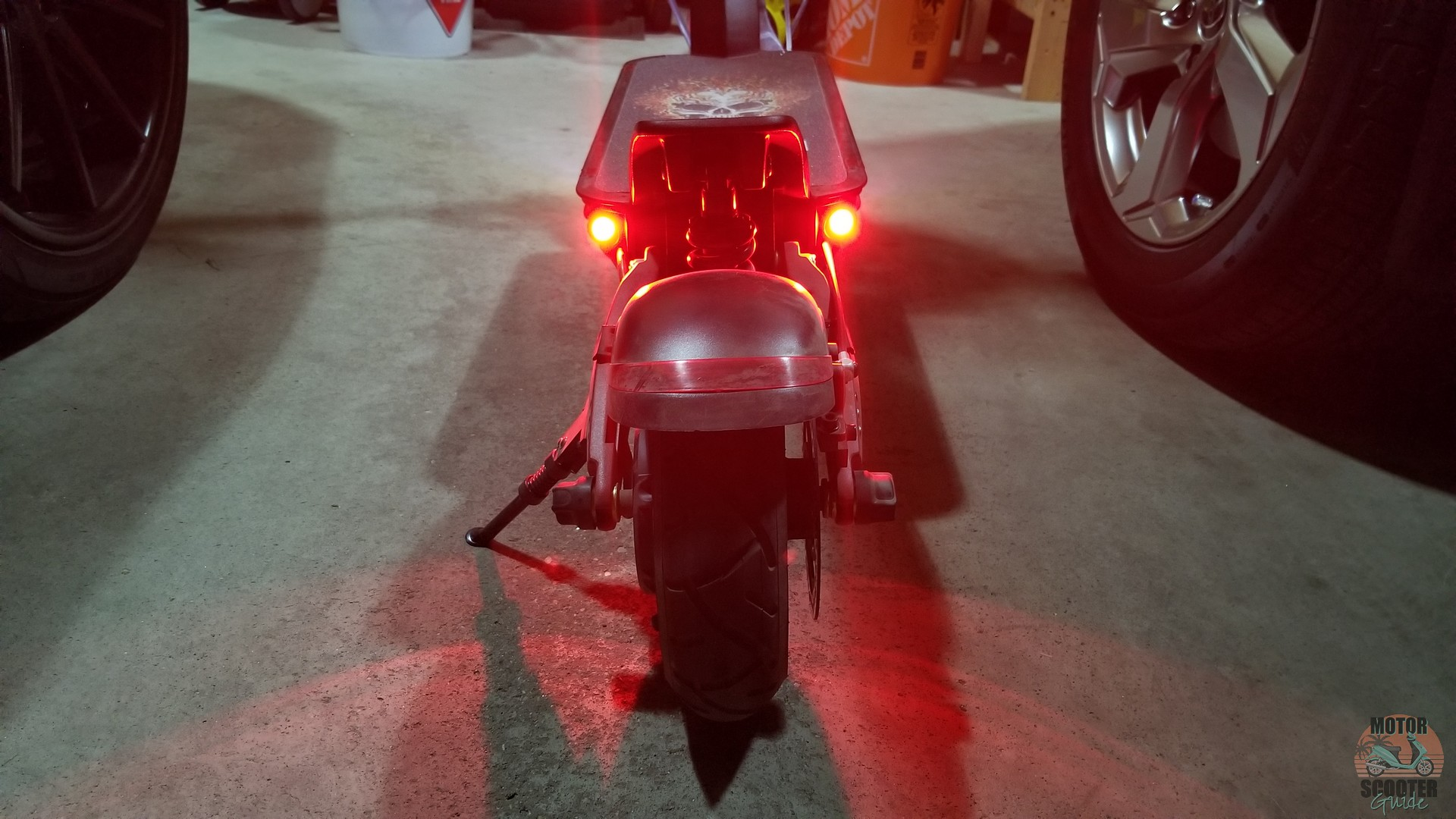 Red LED tail lights on the Varla Eagle One scooter
